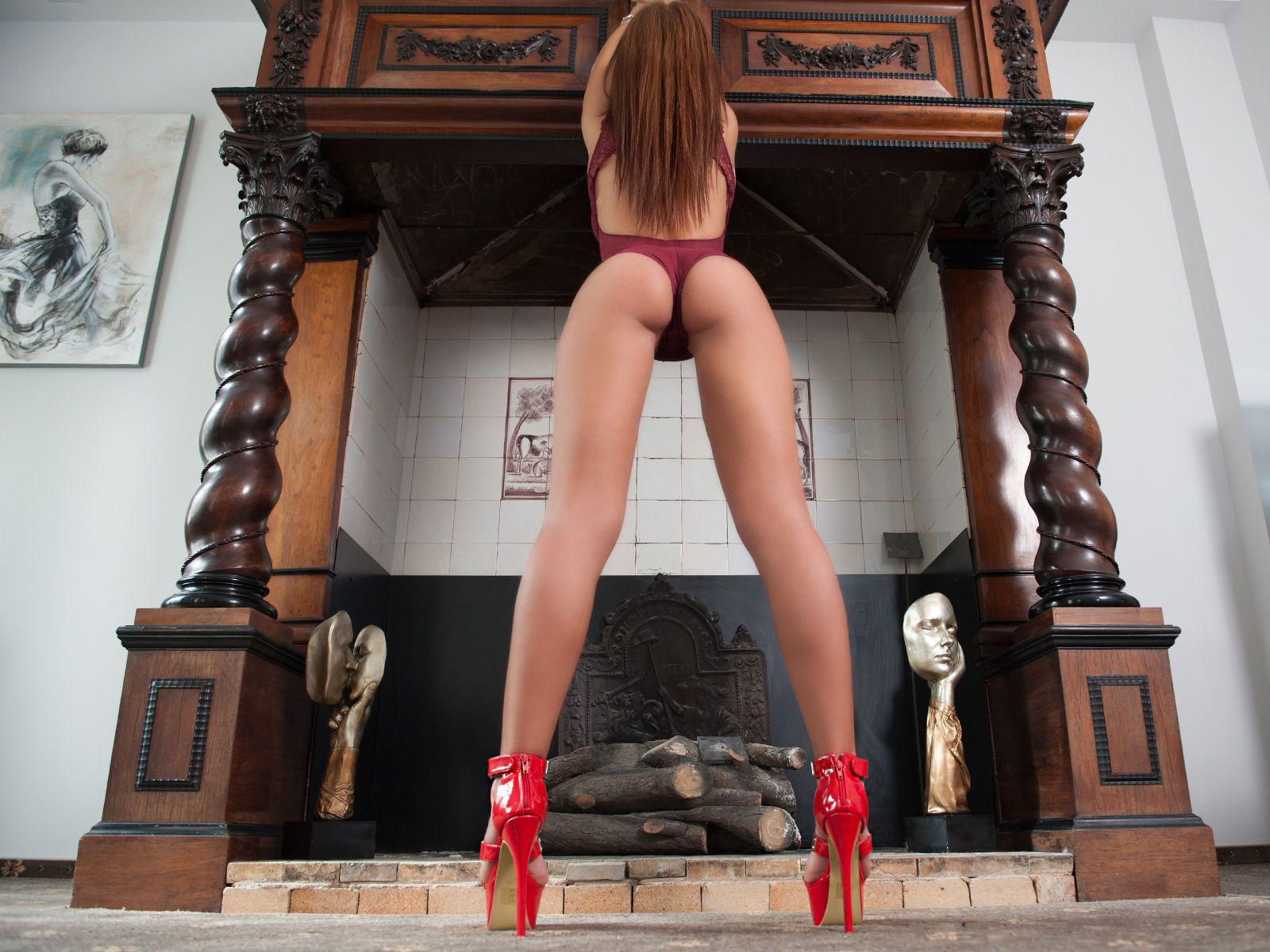 AllisonDesire in front of a fireplace